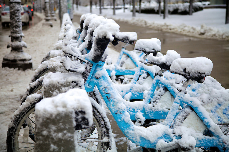 Some lonely Divvy bikes sit under a late season blanket of snow on Chicago's lakefront and Millennium Park as the harsh winter of 2014 keeps its grip on the city for a few more days, March 12, 2014. (DePaul University/Jeff Carrion)