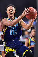 MAR 7, 2016: Baltimore, MD - North Carolina-Wilmington Seahawks guard C.J. Bryce (12) makes a strong move to the basket agasint Hofstra Pride during the Championship game of the CAA Basketball Tournament at Royal Farms Arena in Baltimore, Maryland. (Photo by Philip Peters/Media Images International)