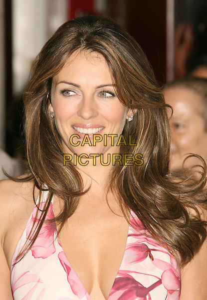 "ELIZABETH HURLEY.""Breast Cancer Awareness Campaign"" held at Saks Fifth Avenue, Beverly Hills, California, USA, 05 October 2007..Liz portrait headshot pink red dream white floral patterned print halterneck dress cleavage.CAP/ADM/RE.©Russ Elliot/AdMedia/Capital Pictures."