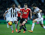 Saido Berahino of West Bromwich Albion tussles with Morgan Schneiderlin of Manchester United - English Premier League - West Bromwich Albion vs Manchester Utd - The Hawthorns Stadium - West Bromwich - England - 6th March 2016 - Picture Simon Bellis/Sportimage