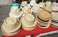 Hats for sale at a kiosk in a street fair in the Greenwich Village neighborhood of New York on Saturday, June 21, 2014. (© Richard B. Levine)