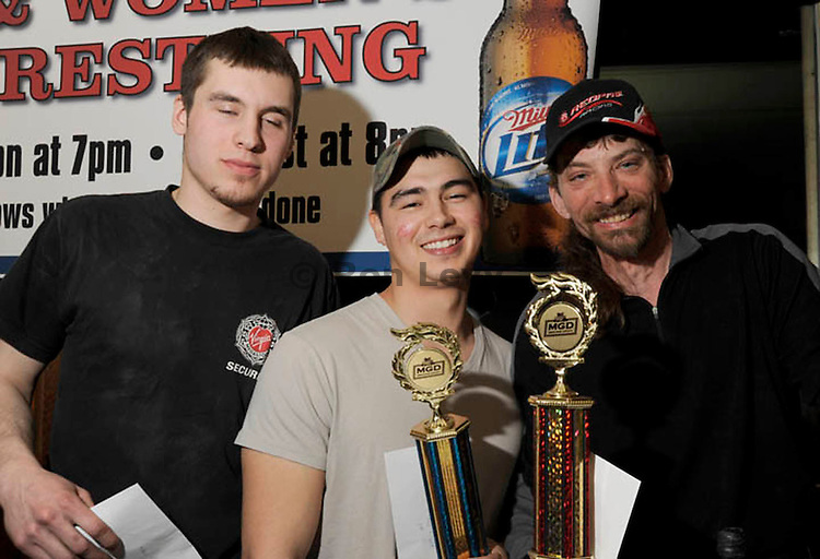 Lance Mackey (2nd place) , Dale Ellaya (1t place, middle) and Alex Morgan (left)  at Arm Wrestling contest, Breaker's Bar, Nome, Alaska, after Iditarod race