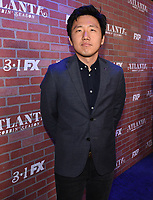 """LOS ANGELES - FEBRUARY 19: Hiro Murai arrives at the red carpet event for FX's """"Atlanta Robbin' Season"""" at the Ace Theatre on February 19, 2018 in Los Angeles, California.(Photo by Frank Micelotta/FX/PictureGroup)"""