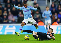 30th November 2019; St James Park, Newcastle, Tyne and Wear, England; English Premier League Football, Newcastle United versus Manchester City;  Raheem Sterling of Manchester City is tackled by Paul Dummett of Newcastle United  - Strictly Editorial Use Only. No use with unauthorized audio, video, data, fixture lists, club/league logos or 'live' services. Online in-match use limited to 120 images, no video emulation. No use in betting, games or single club/league/player publications