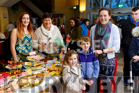 Kaela Helen and Ella Clarkepick up some buns from Lorna and Patricia Lydon at the Christmas craft fair in Killarney Outlet Centre on Sunday
