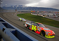 Feb 22, 2009; Fontana, CA, USA; NASCAR Sprint Cup Series driver Jeff Gordon (24) leads teammate Jimmie Johnson (48) during the Auto Club 500 at Auto Club Speedway. Mandatory Credit: Mark J. Rebilas-