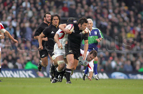 19 November 2005:  New Zealand scrum half Byron Kelleher is tackled during the Invesco Perpetual Series game between England and New Zealand played at Twickenham. New Zealand won the game 23-19. Photo: Kim Fraser/actionplus..051119 all-blacks man men player