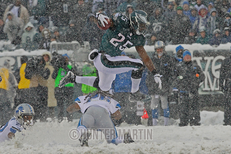 PHILADELPHIA - DECEMBER 8: LeSean McCoy #25 of the Philadelphia Eagles hurdles Louis Delmas #26 of the Detroit Lions on his way to scoring a touchdown during a game on December 8, 2013 at Lincoln Financial Field in Philadelphia, Pennsylvania. The Eagles won 34-20. (Photo by Hunter Martin/Philadelphia Eagles/Getty Images) *** Local Caption *** LeSean McCoy;Louis Delmas