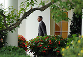 United States President Barack Obama walks from the Oval Office as he prepares to depart the South Lawn of the White House en route to Martha's Vineyard for a ten day vacation on Thursday, August 18, 2011 in Washington..Credit: Roger L. Wollenberg / Pool via CNP