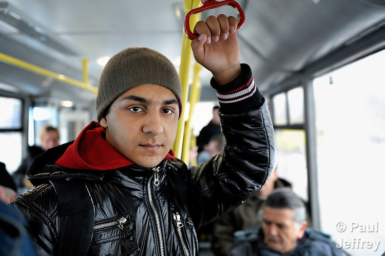 Bajram Kruezi rides a city bus on his way to the Branko Pesic School, an educational center for Roma children and families in Belgrade, Serbia, which is supported by Church World Service. Kruezi's family came to Belgrade as refugees from Kosovo, and like many Roma can't afford regular school fees. Many Roma also lack legal status in Serbia, and thus have difficulty obtaining formal employment and accessing government services. Kruezi wants to be a Muslim religious scholar when he grows up.