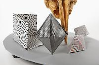 OrigamiUSA 2017 Holiday Tree at the American Museum of Natural History. Base 2 models:<br /> Brain: Designer &ndash; Chris Itoh, Folder &ndash; Chris Itoh<br /> Crystals: Designer &ndash; Robert Neale, Folder &ndash; Rosalind Joyce<br /> Triangular Prism: Designer &ndash; John Montroll, Folder &ndash; Rosalind Joyce<br /> Triangular Dipyramid: Designer &ndash; John Montroll, Folder &ndash; Rosalind Joyce<br /> Magic Cube Optical Illusion: Designer &ndash; Jeremy Shafer, Folder &ndash; Talo Kawasaki