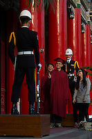 University graduates pose for self portraits with Taiwanese military honour guards at the National Revolutionary Martyrs' Shrine in Zhongshan District, Taipei, Taiwan, 2015. The shrine is dedicated to the war dead of the Republic of China.
