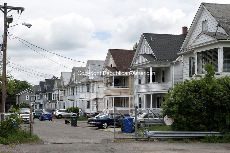 TORRINGTON, CT - 31 MAY 2014 -- A row of multi-family homes on Munson Street, extend to Prospect Street off a parking lot on Field Street where a new courthosue will be built.  Alec Johnson/ Republican-American