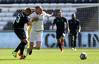 SWANSEA, WALES - MARCH 25: Oli McBurnie of Swansea City is challenged by Diogo Verdasca of Porto during the Premier League International Cup Semi Final match between Swansea City and Porto at The Liberty Stadium on March 25, 2017 in Swansea, Wales. (Photo by Athena Pictures)