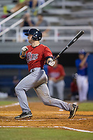 A.J. Murray (22) of the Elizabethton Twins follows through on his swing against the Kingsport Mets at Hunter Wright Stadium on July 8, 2015 in Kingsport, Tennessee.  The Mets defeated the Twins 8-2. (Brian Westerholt/Four Seam Images)