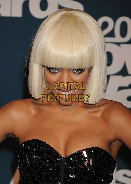 Lil Mama.in the Press Room at the 2011 MTV Movie Awards at Universal Studios' Gibson Amphitheatre in Universal City, California, USA, June 5th 2011.  .pressroom portrait headshot cleavage wig white hair bob strapless black smiling make-up .CAP/ROT/TM.©TM/Roth Stock/Capital Pictures