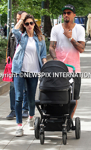 HARDMAN KEVIN PRINCE BOATENG SHOWS HIS SOFTER SIDE<br /> Ex-Tottenham player Kevin Prince Boateng accompanied by fiancee Melissa Satta takes on his fatherly duties pushing the buggy carrying new born son Maddox.<br /> It was a chance for Boateng who was one of Ghana's best players at the 2010 World Cup, to spend some family time prior to joining the Ghanian National team in preparation for this year's World Cup In Brazil.<br /> Ghana will face Germany which Boateng's birthplace, Portugal and USA in the group stage at the World Cup 2014.<br /> Fiancee Melissa Satta, a Sports Illustrated model revealed in January 2012 that the reason Prince Boateng is always injured because they have sex seven to 10 times a week. <br /> Maddox was born on 15th April 2014.<br /> Boateng plays for FC Schalke in the Bundesliga presently.<br /> Mandatory Credit Photo: &copy;Nunzio/NEWSPIX INTERNATIONAL<br /> <br /> **ALL FEES PAYABLE TO: &quot;NEWSPIX INTERNATIONAL&quot;**<br /> <br /> IMMEDIATE CONFIRMATION OF USAGE REQUIRED:<br /> Newspix International, 31 Chinnery Hill, Bishop's Stortford, ENGLAND CM23 3PS<br /> Tel:+441279 324672  ; Fax: +441279656877<br /> Mobile:  07775681153<br /> e-mail: info@newspixinternational.co.uk