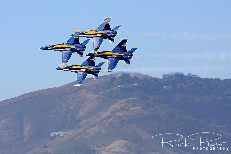 Blue Angel diamond formation in flight backed by the Marin Headlands.