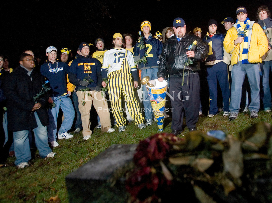 "Michigan alum Jeff Holzhausen, aka ""Superfan I"", leads a group of Michigan students and fans on an annual pilgrimage to visit the graves of former Michigan football greats Fielding H. Yost and Bob Ufer, on Thursday, November 16, 2006 in Ann Arbor, MI. TONY DING/Special to the Free Press"