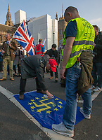 Protesters deface a European flag - BREXIT Protests on the day the UK was due to leave Europe, in Central London, England on 29 March 2019.<br /> Photo by Andy Rowland.