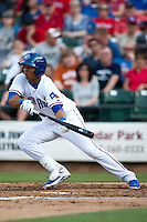Round Rock Express center fielder Leonys Martin #27 lays down a bunt during the MLB exhibition baseball game against the Texas Rangers on April 2, 2012 at the Dell Diamond in Round Rock, Texas. The Rangers out-slugged the Express 10-8. (Andrew Woolley / Four Seam Images).