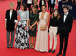 (L-R) Clemence Poesy, Anne Berest, Lola Bessis, Audrey Dana, Christine and The Queens and Freddie Highmore arrive at the opening ceremony of 40th Deauville American Film Festival on September 5, 2014