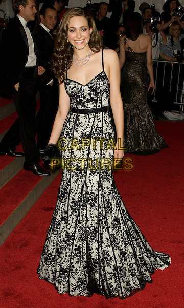 "EMMY ROSSUM.Costume Institute Gala - ""Superheroes: Fashion and Fantasy"" at The Metropolitan Museum of Art, New York, NY, USA..May 5th, 2008 .full length black white lace dress clutch bag .CAP/LNC/TOM.©TOM/LNC/Capital Pictures."