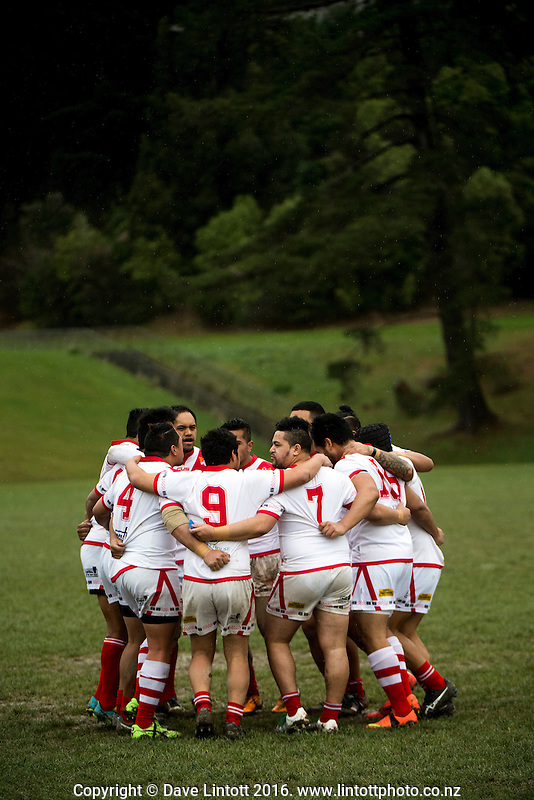 The St George team huddles before the Wellington Rugby League Premiership match between St George Dragons and Petone Panthers at Cannons Creek Park, Wellington, New Zealand on Saturday, 30 July 2016. Photo: Dave Lintott / lintottphoto.co.nz