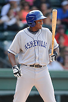 First baseman Correlle Prime (32) of the Asheville Tourists bats in a game against the Greenville Drive on Sunday, July 20, 2014, at Fluor Field at the West End in Greenville, South Carolina. Asheville won game two of a doubleheader, 3-2. (Tom Priddy/Four Seam Images)