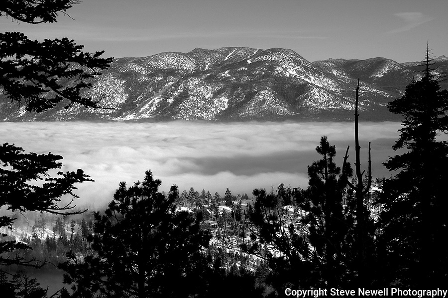 "Heaven's Gate"" BW Heavenly Ski Resort Lake Tahoe, CA. In 2005 a layer of clouds hovered over South Lake Tahoe for three weeks. I finally went out to Emerald Bay and hiked up above the clouds to enjoy this view of Heavenly Valley Ski Resort!!!"