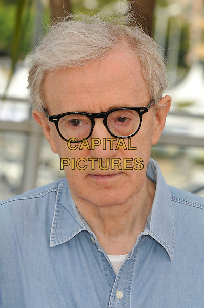 WOODY ALLEN (Director).'Midnight in Paris' photocall at the Palais des Festivals,  64th International Cannes Film Festival, France.11th May 2011..portrait headshot glasses blue shirt denim chambray.CAP/PL.©Phil Loftus/Capital Pictures.
