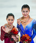 TAIPEI, TAIWAN - JANUARY 25:  Kanako Murakami (R) and Satoko Miyahara of Japan poses with their medals after the Ladies Free Skating event during the Four Continents Figure Skating Championships on January 25, 2014 in Taipei, Taiwan.  Photo by Victor Fraile / Power Sport Images *** Local Caption *** Kanako Murakami; Satoko Miyahara