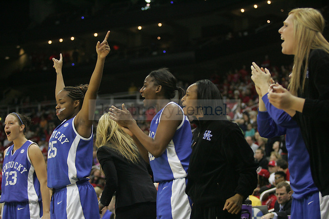 The No. 4 UK Women's Hoops cheers on their team during their second half lead over No. 1 Nebraska on Sunday, March 28, 2010 at the Women's Sweet 16 Tournament in Kansas City, Mo. The Cats defeated the Huskers 76-67, sending the Cats to the Elite 8 for the first time in Kentucky history. Photo by Allie Garza | Staff
