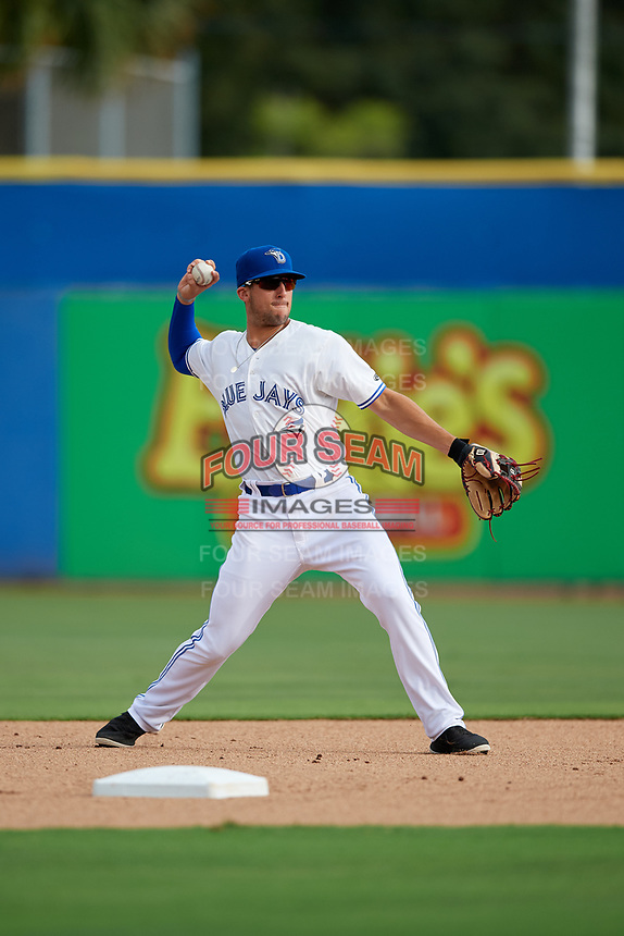 Dunedin Blue Jays second baseman Kevin Smith (4) throws to first base during a game against the Lakeland Flying Tigers on July 31, 2018 at Dunedin Stadium in Dunedin, Florida.  Dunedin defeated Lakeland 8-0.  (Mike Janes/Four Seam Images)