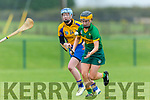 Kerry's Captain Aoife Behan gets away from clare's Louise Browne at the Littlewoods Ireland Camogie League Division 3 Kerry v Clare at Abbeydorney GAA club on Sunday