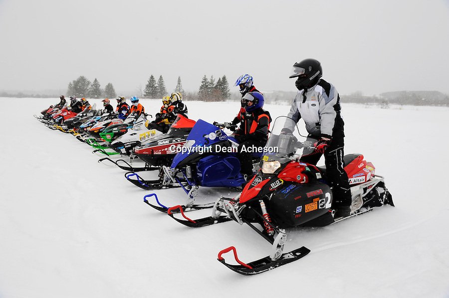 Competitors wait for their test run during the 2008 SAE Clean Snowmobile Challenge, a competition among US and international universities to develop a prototype snowmobile that meets the 2012 standards for exhaust emissions and noise output. The Society of Automotive Engineers' ninth annual event culminated with an acceleration and handling competition held Saturday, March 15 at Keweenaw Research Center, just outside of Houghton, Mich. Unlike last year's competition that saw muddy track conditions, this year's competitors had just light snow flurries as well as excellent track conditions.