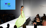 MIAMI, FL - FEBRUARY 13: Models walk the runway during an Oscar De La Renta fashion show during the Designed For A Cure 2014 Benefiting Sylvester Comprehensive Cancer Center at Ice Palace on February 13, 2014 in Miami, Florida. (Photo by Johnny Louis/jlnphotography.com)
