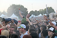 A man doing the devil signs is crowd surfing during a concert at the Festival d'ete de Quebec in Quebec City Saturday July 14, 2012.