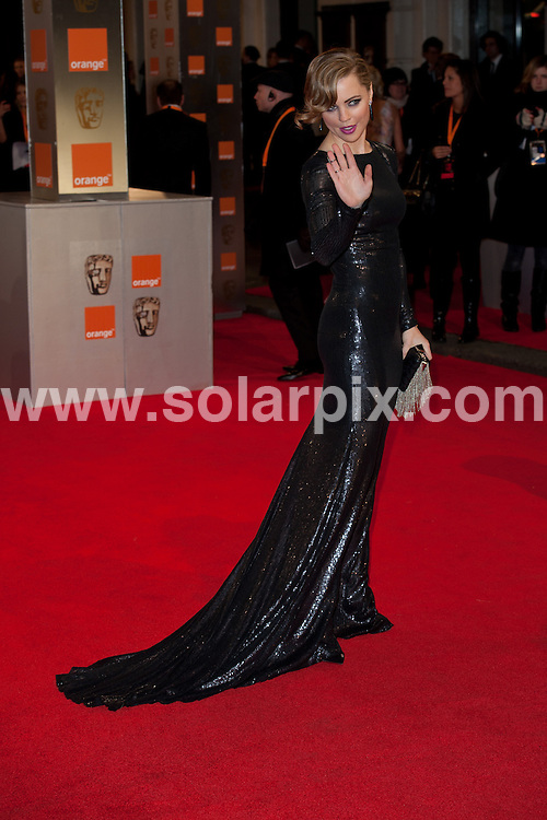 **ALL ROUND PICTURES FROM SOLARPIX.COM**                                             **WORLDWIDE SYNDICATION RIGHTS**                                                                                  Caption: Orange British Academy Film Awards at The .Royal Opera House in Covent Garden London                                                                              This pic:  Melissa George                                                                                    JOB REF:14469        WMB      DATE: 12.02.2012                                                           **MUST CREDIT SOLARPIX.COM OR DOUBLE FEE WILL BE CHARGED**                                                                      **MUST AGREE FEE BEFORE ONLINE USAGE**                               **CALL US ON: +34 952 811 768 or LOW RATE FROM UK 0844 617 7637**