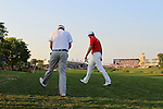 Ian Poulter and Robert Karlsson walk up to play their 2nd shots from the rough on the 18th, 1st playoff hole, during the Final Day of the Dubai World Championship, Earth Course, Jumeirah Golf Estates, Dubai, 28th November 2010..(Picture Eoin Clarke/www.golffile.ie)