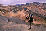 Photographer on trail, Landmannalaugar, Fjallbak Nature Reserve, Iceland