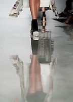 """Una modella presenta una creazione di Comeforbreakfast, finalista del progetto """"Who is on next?"""", durante la rassegna Altaroma a Roma, 8 luglio 2013.<br /> A model wears a creation by Comeforbreakfast, finalist of """"Who is on next?"""" project, during the Altaroma fashion week in Rome, 8 July 2013.<br /> UPDATE IMAGES PRESS/Virginia Farneti"""