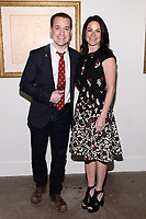 "NEW YORK CITY - APRIL 20: (L-R) Actor  T.R. Knight and Courteney Monroe, CEO, National Geographic Global Networks, attend a Sotheby's lunch and private preview of works by Picasso in conjunction with the National Geographic show ""Genius: Picasso"" at Sotheby's on April 20, 2018 in New York City. (Photo by Anthony Behar/ National Geographic/PictureGroup)"
