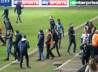 Anthony Stewart of Wycombe Wanderers leaves the pitch at full time as the Coventry supporters invade the pitch to celebrate reaching the Wembley cup final during the The Checkatrade Trophy - EFL Trophy Semi Final match between Coventry City and Wycombe Wanderers at the Ricoh Arena, Coventry, England on 7 February 2017. Photo by Andy Rowland.