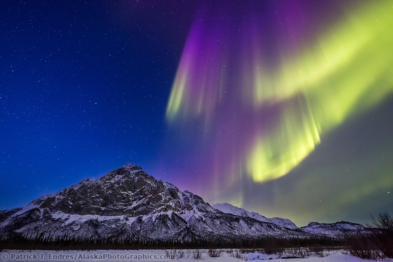 Aurora dances over Mt Dillon of the Brooks Range mountains in Alaska's arctic.