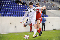 Dillon Powers (8) of the Notre Dame Fighting Irish is defended by J.T. Murray (23) of the Louisville Cardinals. The Louisville Cardinals defeated the Notre Dame Fighting Irish 1-0 during the semi-finals of the Big East Men's Soccer Championship at Red Bull Arena in Harrison, NJ, on November 12, 2010.