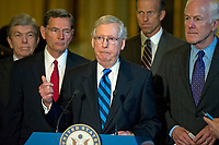 United States Senate Majority Leader Mitch McConnell (Republican of Kentucky), center, speaks to reporters following the Republican Party luncheon in the United States Capitol in Washington, DC on Tuesday, July 11, 2017.  From left to right: US Senator Roy Blunt (Republican of Missouri), US Senator John Barrasso (Republican of Wyoming), Leader McConnell, US Senator John Thune (Republican of South Dakota) and US Senator John Cornyn (Republican of Texas).  In his remarks, McConnell announced he will keep the Senate in session for the first two weeks of August, delaying their summer recess. Photo Credit: Ron Sachs/CNP/AdMedia