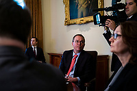 Mick Mulvaney, acting White House chief of staff, listens as U.S. President Donald Trump speaks during a cabinet meeting in the Cabinet Room of the White House, on Wednesday, Jan. 2, 2019 in Washington, D.C. Photo Credit: Al Drago/CNP/AdMedia