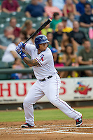 Round Rock Express outfielder Michael Choice (20) at bat during the Pacific Coast League baseball game against the Oklahoma City RedHawks on August 1, 2014 at the Dell Diamond in Round Rock, Texas. The Express defeated the RedHawks 6-5. (Andrew Woolley/Four Seam Images)