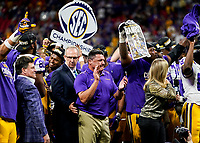ATLANTA, GA - DECEMBER 7: head coach Ed Orgeron of the LSU Tigers celebrates after the game during a game between Georgia Bulldogs and LSU Tigers at Mercedes Benz Stadium on December 7, 2019 in Atlanta, Georgia.